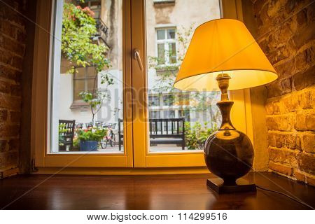 A beautiful lampshade on the window, the house.