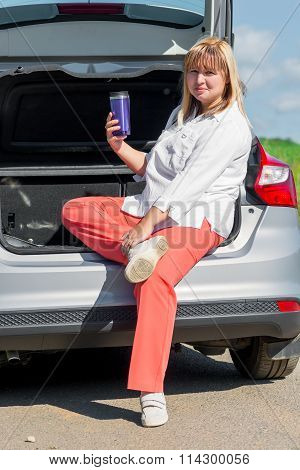 Woman 50 Years Old With A Drink In The Car To Have A Picnic