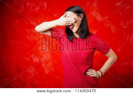 Woman covering her eyes with one hand