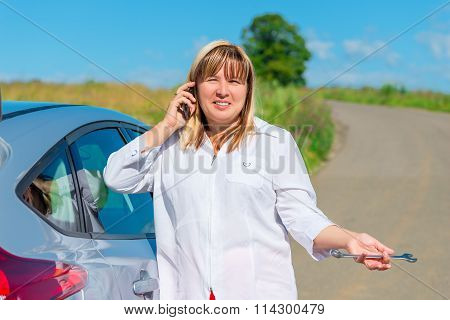Portrait Of A Woman Of 50 Years, Calling For A Car Mechanic By Phone