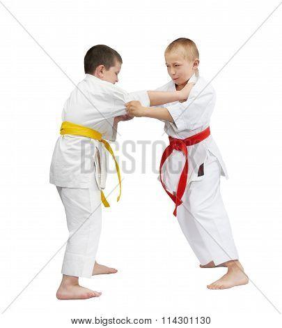 Children are training judo techniques