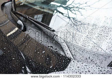 Black Car Hood Fragment And Windshield Wipers