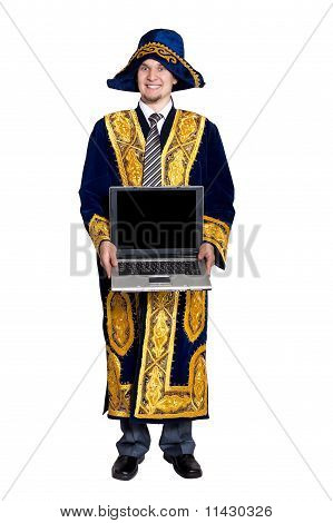 Businessman In National Kazakh Costume With Laptop