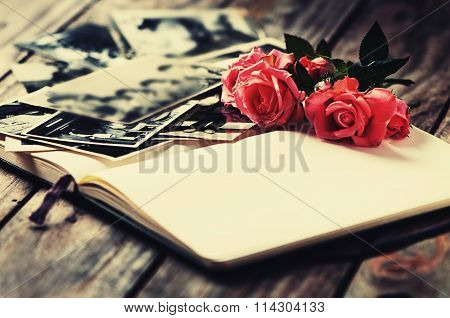 Photoalbum With Rose On Wooden Table