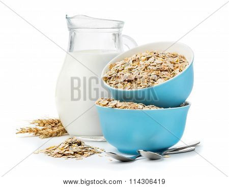 Muesli In Blue bowls And Milk Jug Isolated On White