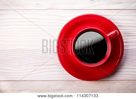 Red Coffee Cup On Light Wooden Table