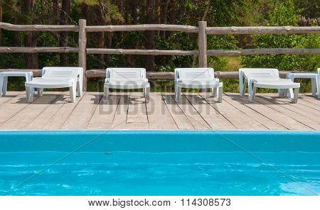 chaise lounges around the pool