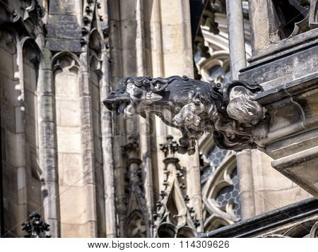 One of many stone demon gargoyles as a part of Metropolitan Cathedral of Saints Vitus, Wenceslaus and Adalbert, Prague Castle, Czech Republic