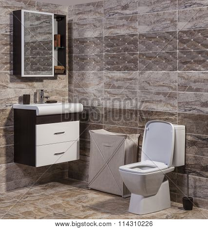 Inside Of Fashionable Bathroom - Toilet And Sink And Modern Ceramic Tiles