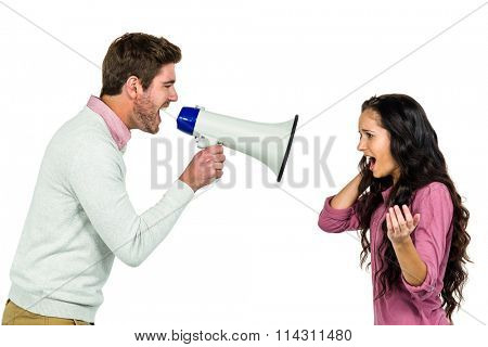 Screaming couple with man holding loudspeaker on white background