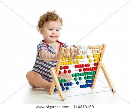 Baby playing with abacus toy. Concept of early learning child
