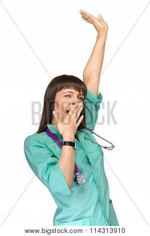 Woman doctor tired yawning