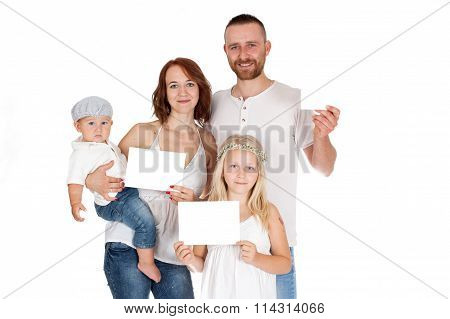 family and group of people in white shirts and jeans holding in the hands of white cards