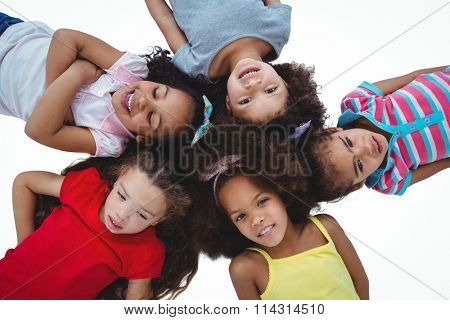 Cute girls laying on a circle on white screen