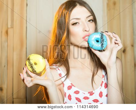 Young Woman With Doughnuts