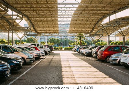 Cars on a parking lot in sunny summer day in Fuengirola, Spain