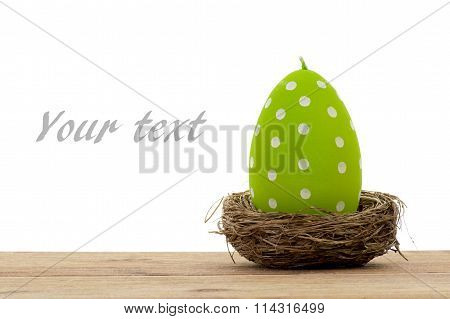Easter decoration- green candles in the shape of egg isolated.