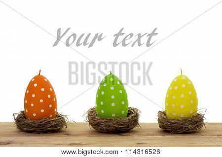 Easter decoration - colorful candles in the shape of egg isolated.