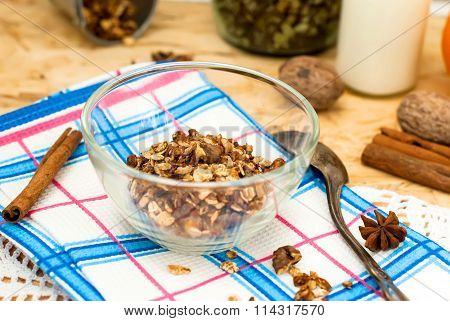 Bowl Of Granola Oatmeal With Walnuts And Honey In A Jar, A Bottle Of Yogurt