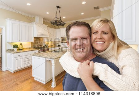 Happy Couple Hugging Inside Beautiful Custom Kitchen.