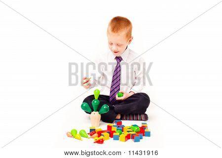 a boy  plays with blocks