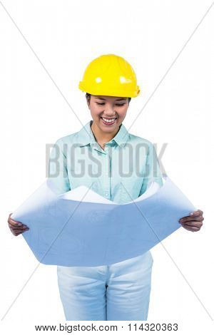 Architect reading a plan with yellow helmet against white background