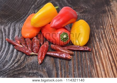 Colored Peppers On Wooden Background