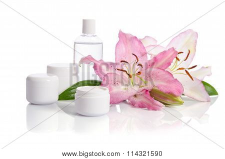 Cosmetic Set For Skin Care On A White Background With Flowers Lilies