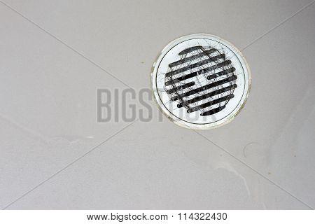 Hair clump in bath drain while taking a shower.