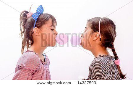 Portraits Of Beautiful Little Girls Blowing Bubbles