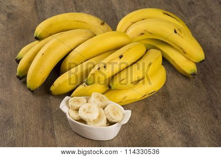 A Banch Of Bananas And A Sliced Banana
