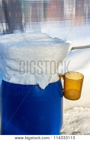 Plastic Barrels Filled With Snow