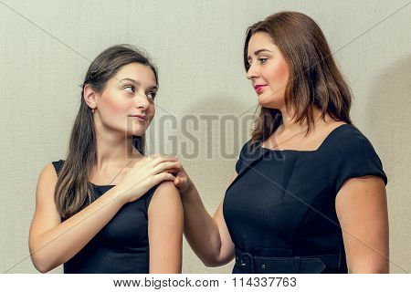 Middle-aged woman and her adult daughter reconciled after a quarrel.