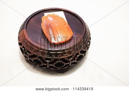 Chinese Amulet Made Of Red Stone With Carving