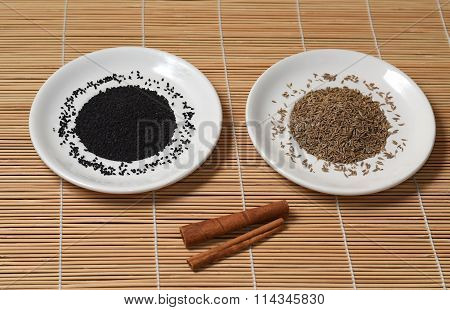 Two White Plate With Spices On A Bamboo Mat
