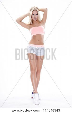 silhouette of a beautiful young adult attractive sexy and sensuality pretty cheerful blonde woman in sporty outfit isolated on white background
