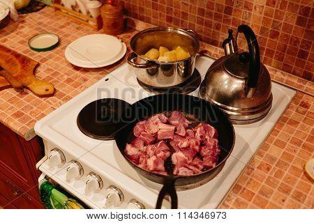 Meat in a frying pan