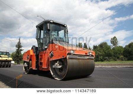 Large Road-roller Paving A Road. Road Construction