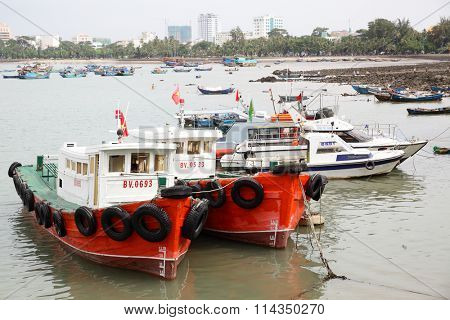 VUNG TAU, VIETNAM - December 16, 2015: Old fishing boats in the port of Vung Tau