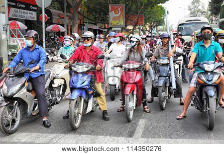 HO CHI MINH CITY, VIETNAM - December 18, 2015 : Crowd of motorcyclists in the center of Ho Chi Minh City (Saigon)