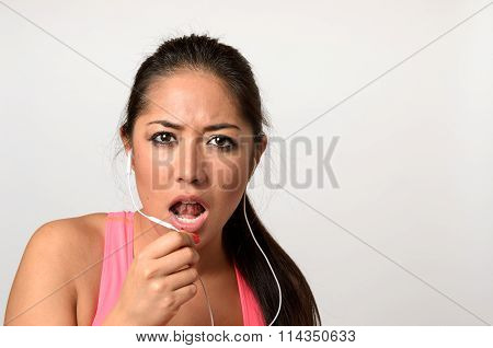 Young Woman Having A Telephone Call With Her Earplugs