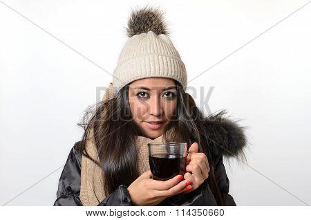 Attractive Brunette Enjoying A Mug Of Hot Tea
