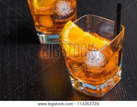 Two Glasses Of Spritz Aperitif Aperol Cocktail With Orange Slices And Ice Cubes