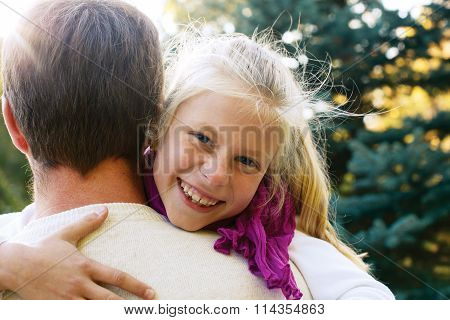 Happy Family - Cute Girl Covers Her Dad's Eyes While Playing At The Outdoors