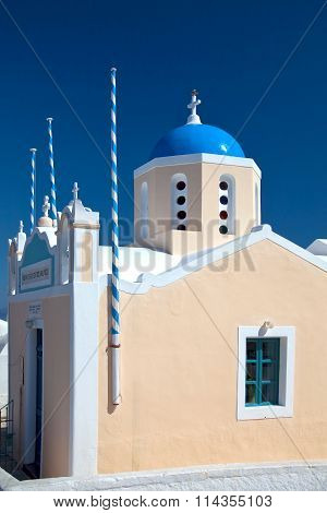 Traditional and famous churches with blue domes over the Caldera