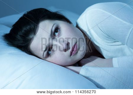 Worried Girl In Bed