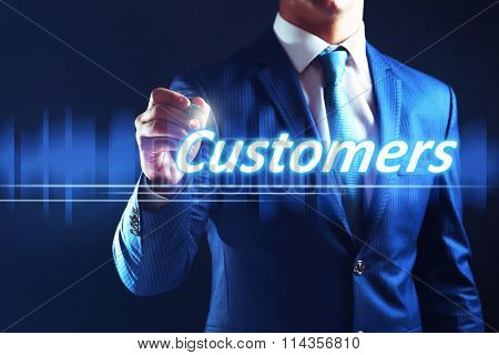 Businessman writing customers on virtual screen. Internet and networking concept.