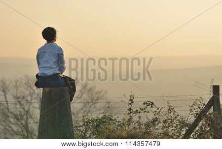 Young woman overlooking a rural scene