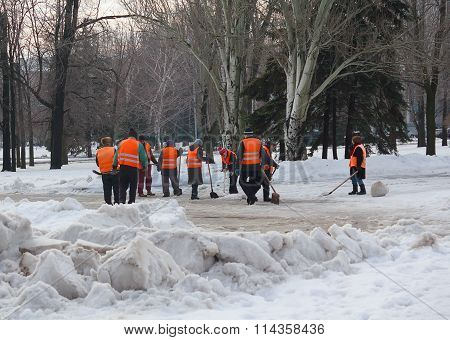 Makeevka, Ukraine - January 14, 2016: Utility Workers Using Shovels Snow From The Road Clean