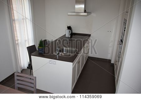 Kitchen Modern Style. Combined Kitchen And Dining Room With Black And White Walls, Black Furniture A
